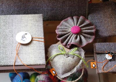A handful of our hand-made tweed products in Falkland Landscape